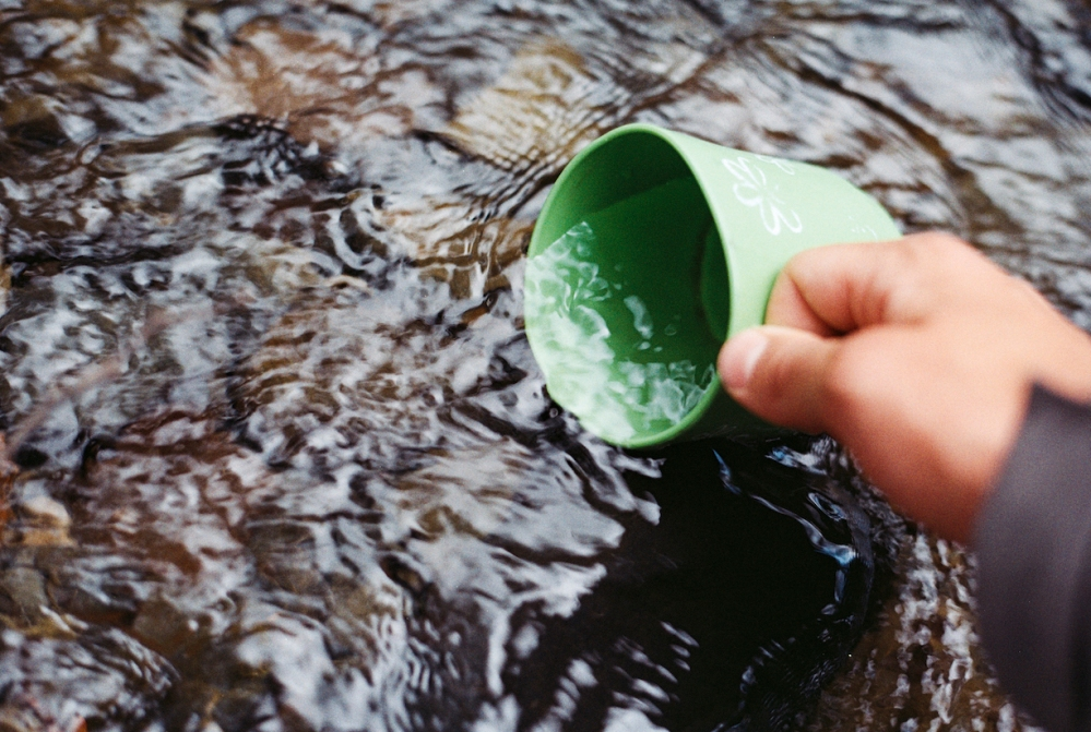 cup in stream stock photo