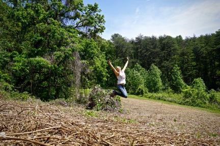 jumping for joy in kudzu field