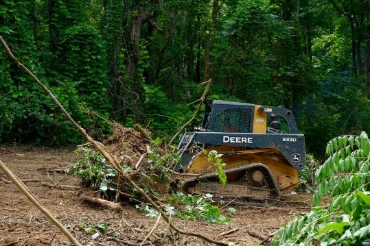 excavator building driveway