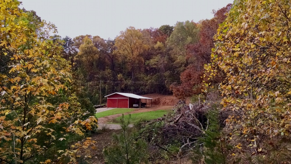 red pole barn with fall colors