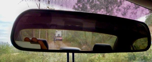 semi truck in rearview mirror