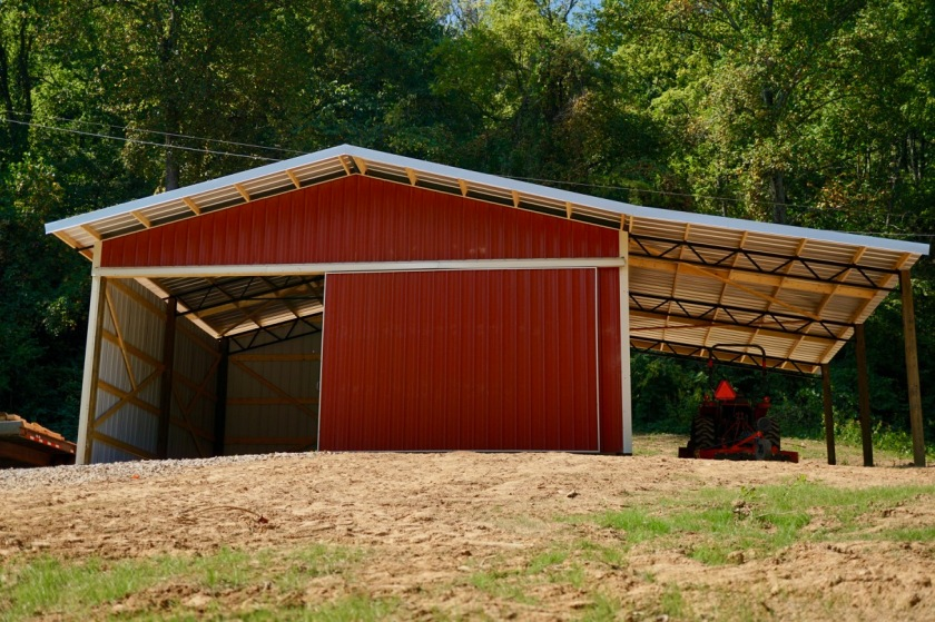 red pole barn with tractor