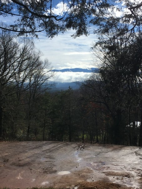 view of the Great Smoky Mountains with muddy house pad