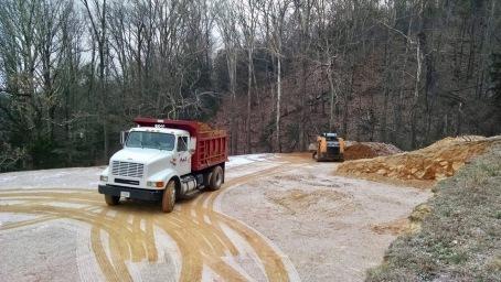 excavators on the housepad with snow