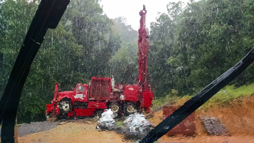 drill rig in the rain through the windshield