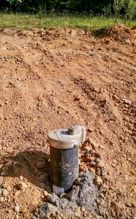 well pipe on red clay