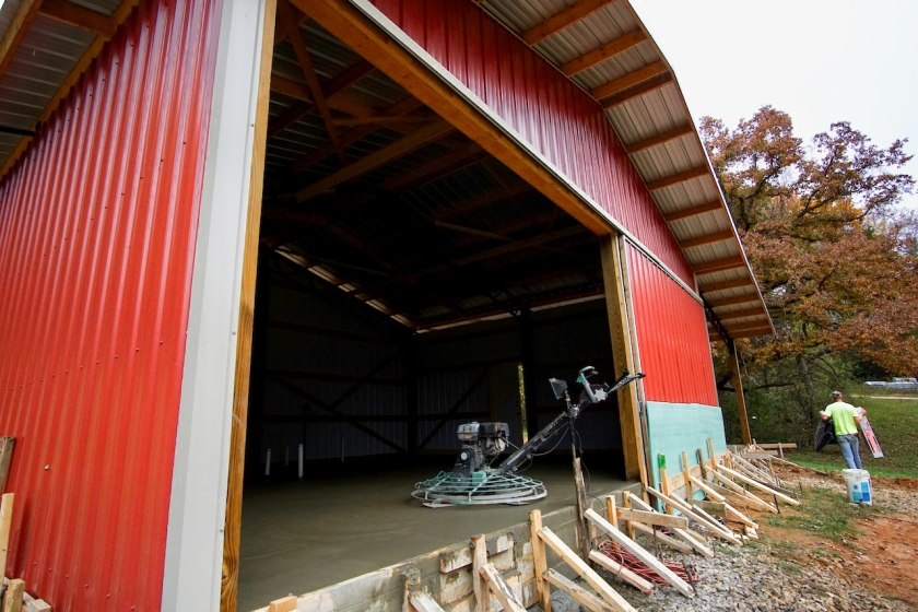 red barn with concrete polishing machine