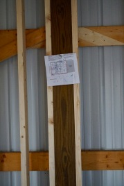 house plans nailed on a beam