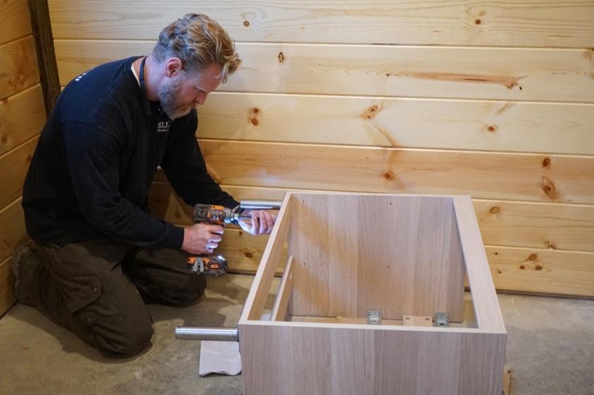 man working on IKEA bathroom vanity