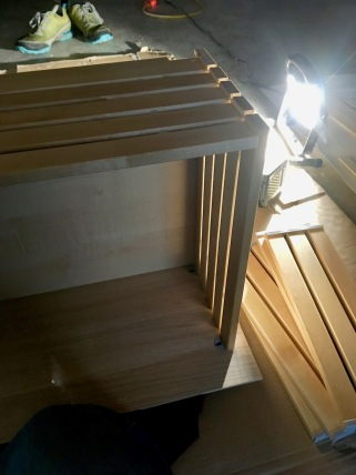 IKEA drawer being built by flashlight