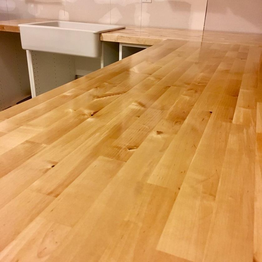 butcher block countertops in new construction kitchen