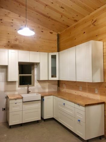 new construction IKEA kitchen installation in mountain cabin