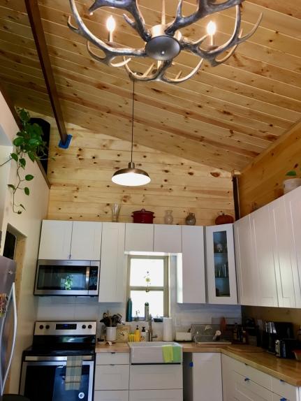 kitchen of barndominium with antler chandelier