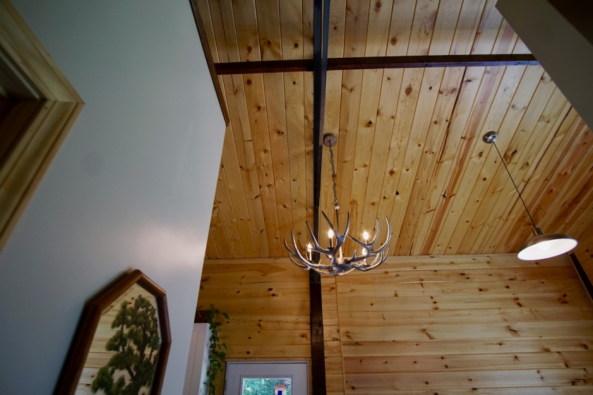 tongue and groove ceiling with antler chandelier