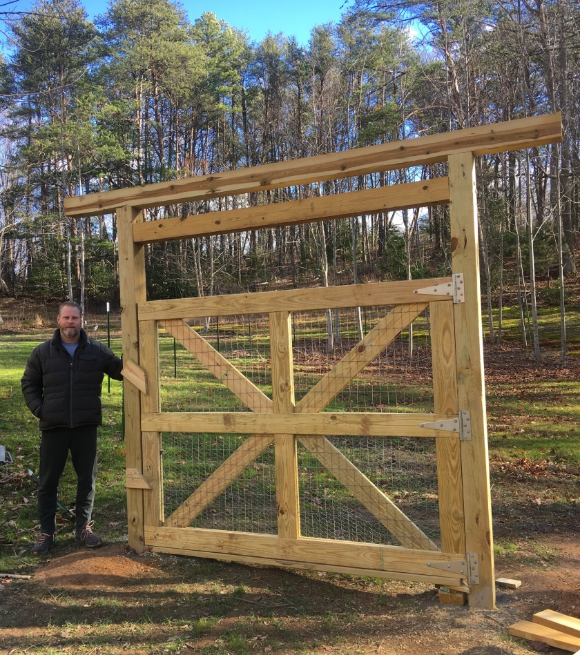 man in front of custom gate